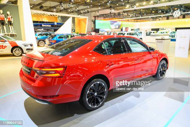 Škoda SupberB sedan in red three quarter rear view on display at Brussels Expo on January 9, 2020 in Brussels, Belgium. The third generation of the...