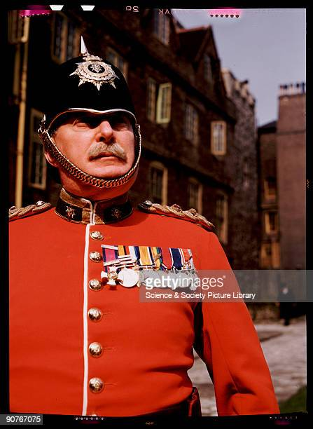 Kodachrome colour photograph of a veteran soldier taken by JCA Redhead during World War Two The soldier wears the scarlet dress uniform of an officer...