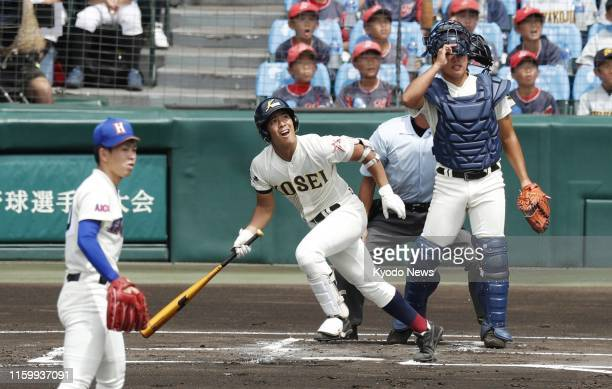 Kodai Shimoyama of Hachinohe Gakuin Kosei hits a grand slam in the first inning against Homare on the opening day of the national high school...