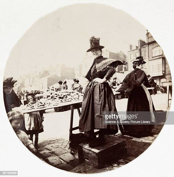 Kodak circular snapshot photograph of a woman at a market stall taken by an unknown photographer in about 1890 The origins of popular photography can...