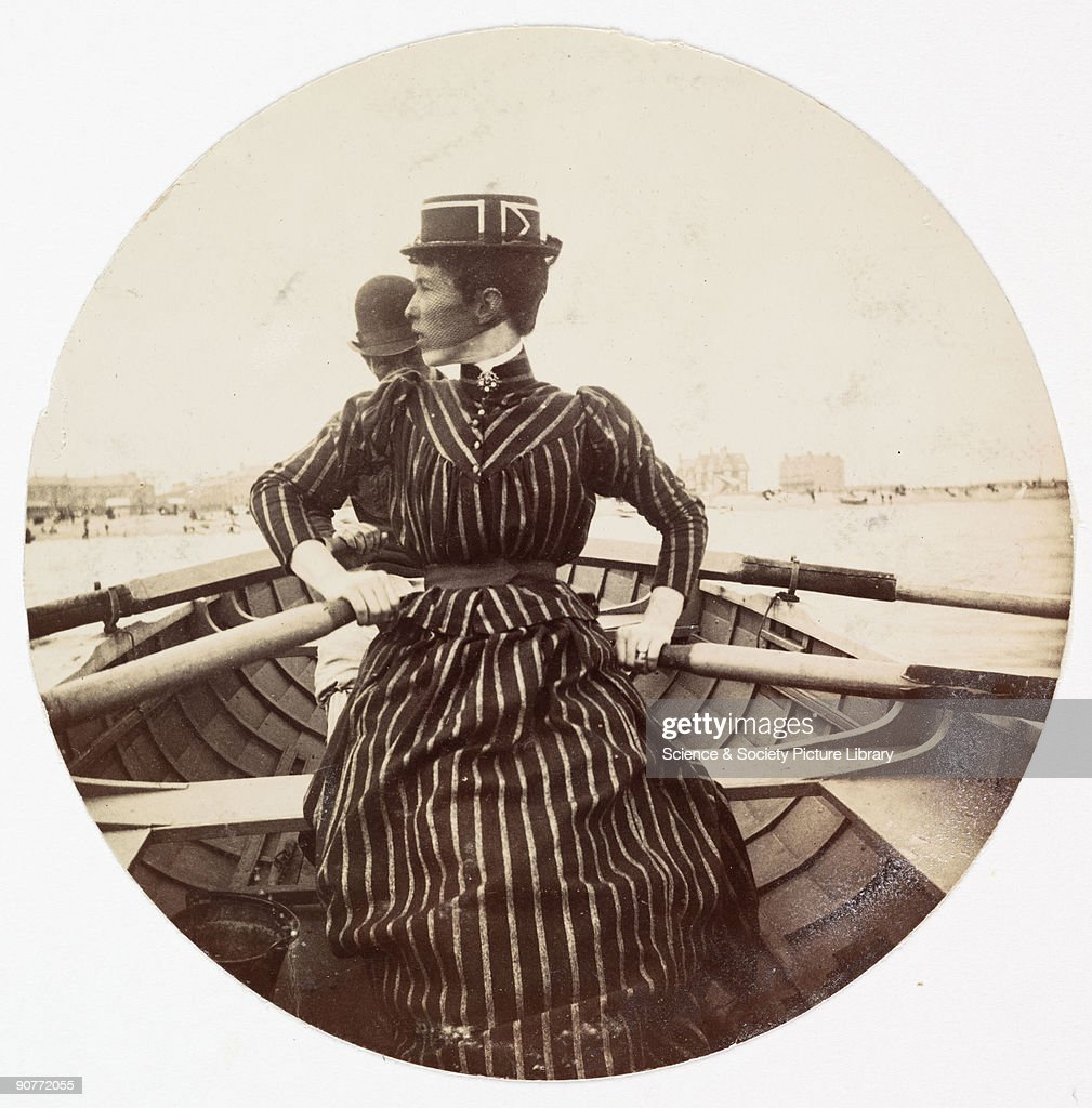 Woman in a rowing boat, c 1890. : News Photo