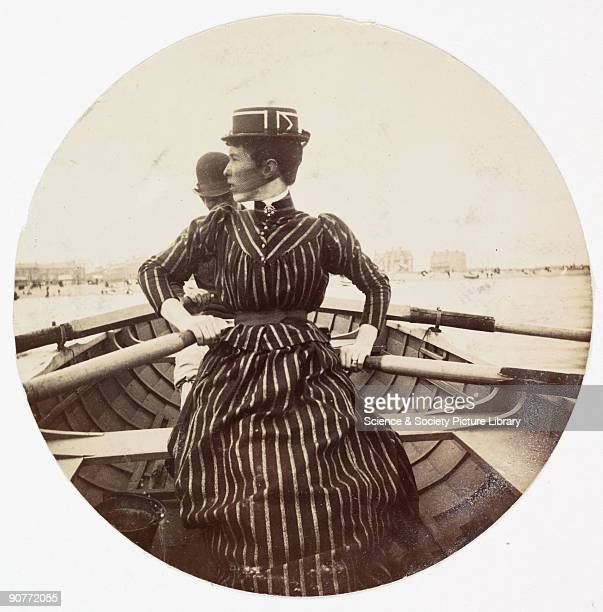 Kodak circular snapshot photograph of a woman in a rowing boat taken by an unknown photographer in about 1890 The woman wears a striking striped...