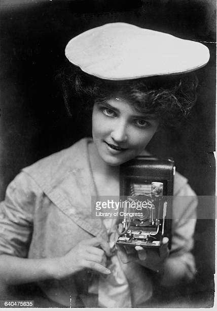 """Kodak Girl"" with Kodak Folding Pocket No. 3."