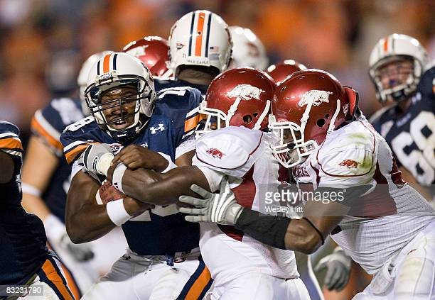 Kodi Burns of the Auburn Tigers is is stopped at the line of scrimmage by the Arkansas Razorbacks defense at JordanHare Stadium on October 11 2008 in...