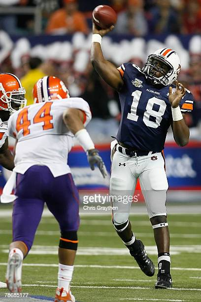 Kodi Burns of the Auburn University Tigers throws a pass over Scotty Cooper of the Clemson University Tigers during the ChickFilA Bowl on December 31...