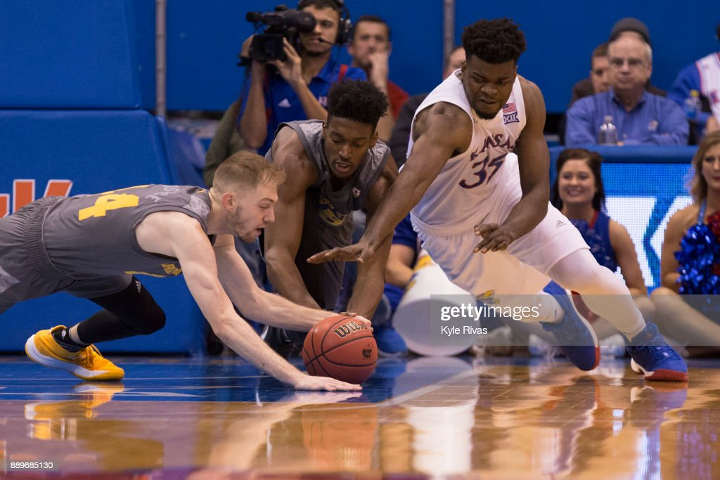 Kodi Justice #44 and De'Quon Lake #35 of the Arizona State Sun Devils dive past Udoka Azubuike #35 of the Kansas Jayhawks in the second half at Allen Fieldhouse on December 10, 2017 in Lawrence, Kansas.
