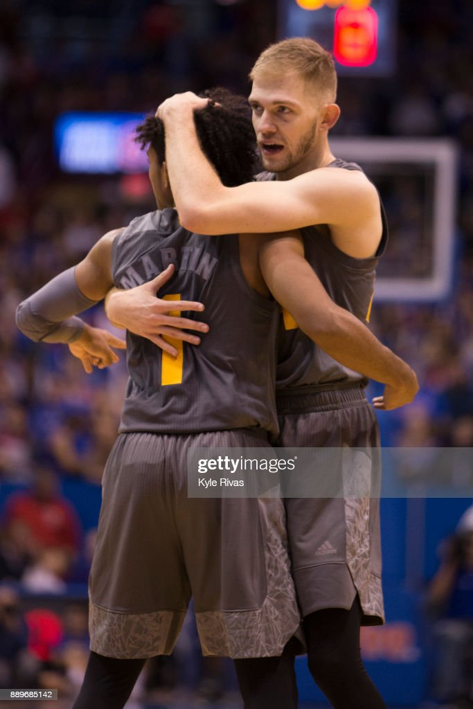 Kodi Justice #44 and Remy Martin #1 of the Arizona State Sun Devils celebrate after upsetting the Kansas Jayhawks at Allen Fieldhouse on December 10, 2017 in Lawrence, Kansas.