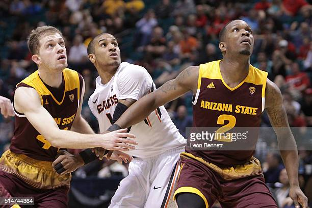Kodi Justice and Willie Atwood of the Arizona State Sun Devils box out Gary Payton II of the Oregon State Beavers during a firstround game of the...