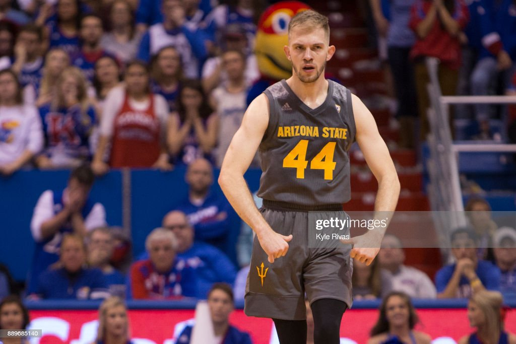 Kodi Justice #44 of the Arizona State Sun Devils celebrates after scoring a three point shot against the Kansas Jayhawks in the second half at Allen Fieldhouse on December 10, 2017 in Lawrence, Kansas.