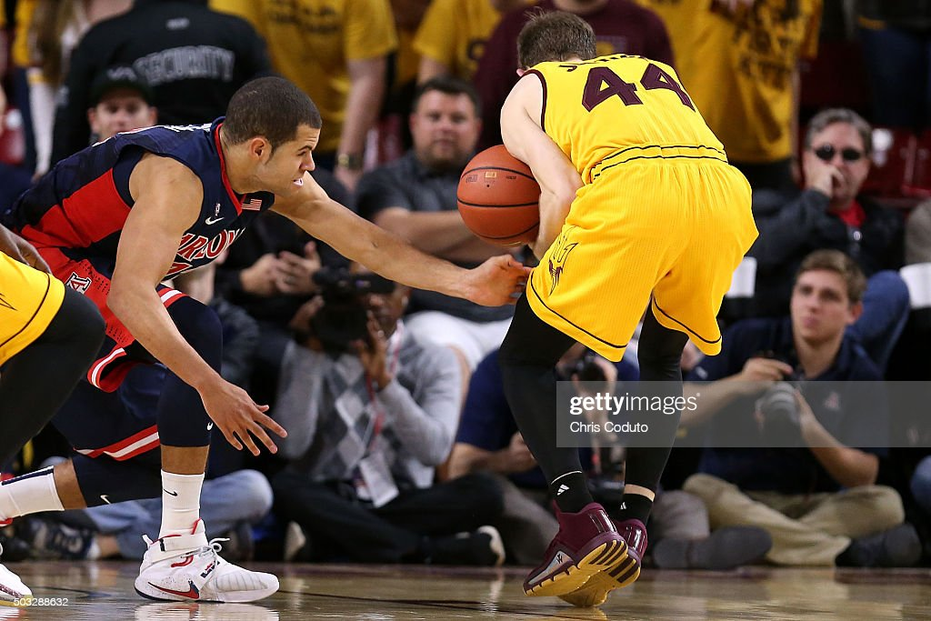 Kodi Justice #44 of the Arizona State Sun Devils rips the ball away from Ryan Anderson #12 of the Arizona Wildcats during the second half of the college basketball game at Wells Fargo Arena on January 3, 2016 in Tempe, Arizona. The Arizona Wildcats beat the Arizona State Sun Devils 94-82.