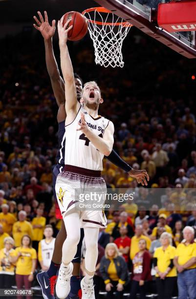 Kodi Justice of the Arizona State Sun Devils shoots over Deandre Ayton of the Arizona Wildcats during the second half of the college basketball game...