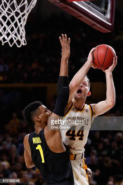 Kodi Justice of the Arizona State Sun Devils shoots over Kenny Wooten of the Oregon Ducks during the first half of the college basketball game at...