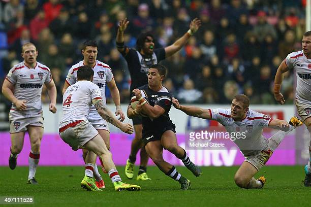 Kodi Nikorima of New Zealand evades the grasp of Tom Burgess of England during the third International Rugby League Test Series match between England...