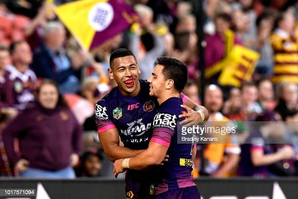Kodi Nikorima of the Broncos is congratulated by team mate Jamayne Isaako after scoring a try during the round 23 NRL match between the Brisbane...