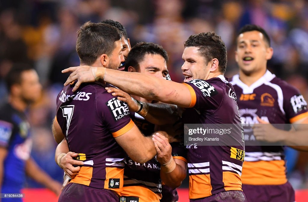 Kodi Nikorima of the Broncos is congratulated by team mates after scoring a try during the round 20 NRL match between the Brisbane Broncos and the Canterbury Bulldogs at Suncorp Stadium on July 20, 2017 in Brisbane, Australia.