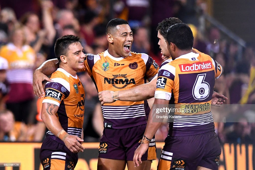 Kodi Nikorima of the Broncos is congratulated by team mates after scoring a try during the round two NRL match between the Brisbane Broncos and the North Queensland Cowboys at Suncorp Stadium on March 16, 2018 in Brisbane, Australia.