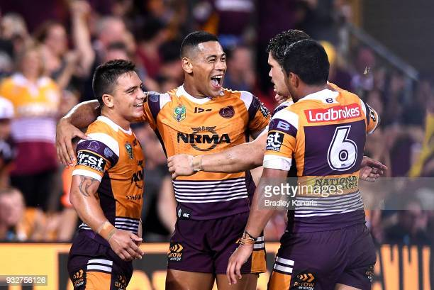 Kodi Nikorima of the Broncos is congratulated by team mates after scoring a try during the round two NRL match between the Brisbane Broncos and the...