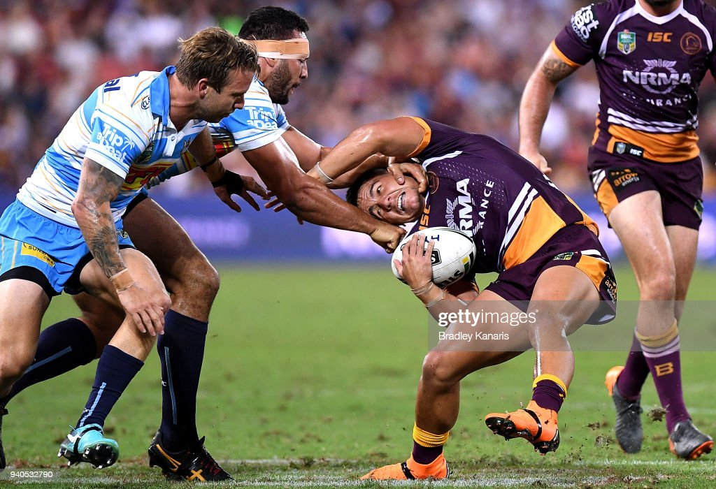 Kodi Nikorima of the Broncos is tackled by Ryan James of the Titans during the round four NRL match between the Brisbane Broncos and the Gold Coast Titans at Suncorp Stadium on April 1, 2018 in Brisbane, Australia.