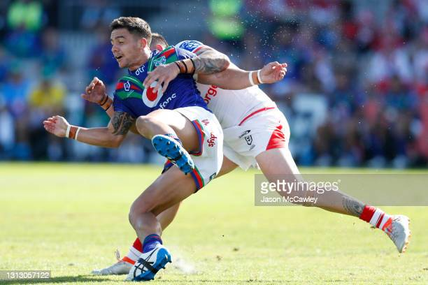 Kodi Nikorima of the Warriors is tackled by Jack Bird of the Dragons during the round six NRL match between the St George Illawarra Dragons and the...