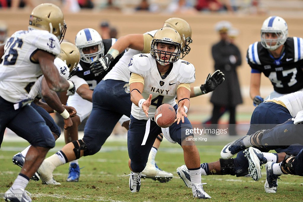 Kody Akers #4 of the Navy Midshipmen tosses the ball against the Duke Blue Devils at Wallace Wade Stadium on October 12, 2013 in Durham, North Carolina. Duke defeated Navy 35-7.