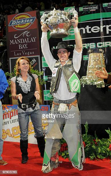Kody Lostroh is joined by his wife Candace after winning the 2009 Professional Bull Riders World Champion at the Built Ford Tough World Finals on...