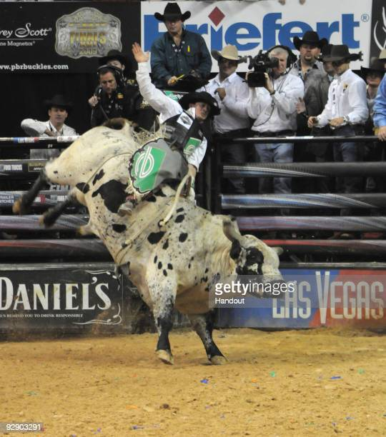 Kody Lostroh rides Voodoo Child to victory during the 2009 Professional Bull Riders World Champion at the Built Ford Tough World Finals on November 8...