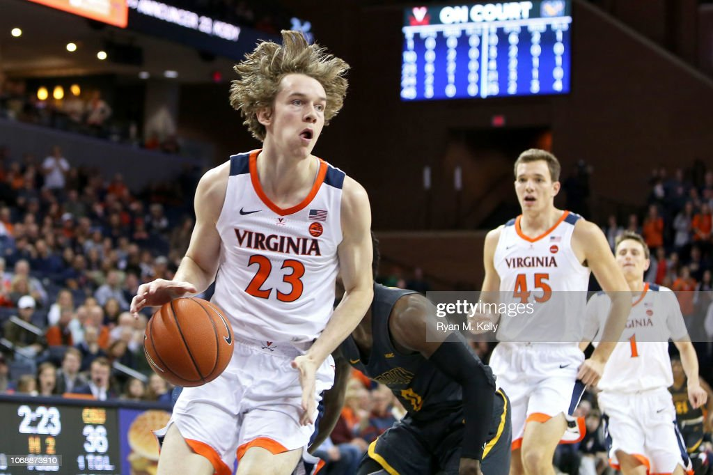 Kody Stattmann Of The Virginia Cavaliers Drives To The Basket In The