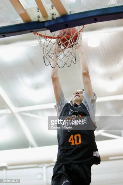 Kody Wade Stattman dunks during the NBL Combine 2017/18 at Melbourne Sports and Aquatic Centre on April 18 2017 in Melbourne Australia