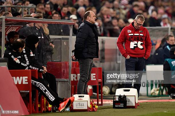 Koeln Director of Sports Joerg Schmadtke and head coach Peter Stoeger look dejected during the Bundesliga match between 1 FC Koeln and Hertha BSC at...