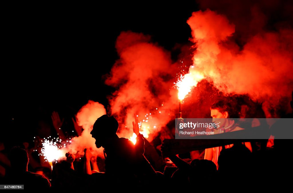 Koeln fans celebrate the first goal as a flare goes off during the UEFA Europa League group H match between Arsenal FC and 1. FC Koeln at Emirates Stadium on September 14, 2017 in London, United Kingdom.