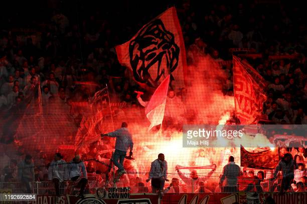 Koeln fans light flares during the Bundesliga match between 1. FC Union Berlin and 1. FC Koeln at Stadion An der Alten Foersterei on December 08,...