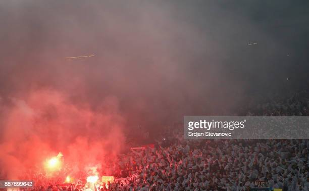 Koeln fans light torches prior to the UEFA Europa League group H match between Crvena Zvezda and 1 FC Koeln at stadium Rajko Mitic on December 7 2017...