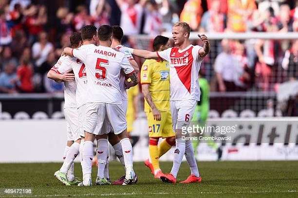 Koeln players celebrate as Anthony Ujah of 1 FC Koeln celebrates scores the second goal during the Bundesliga match between 1 FC Koeln and 1899...