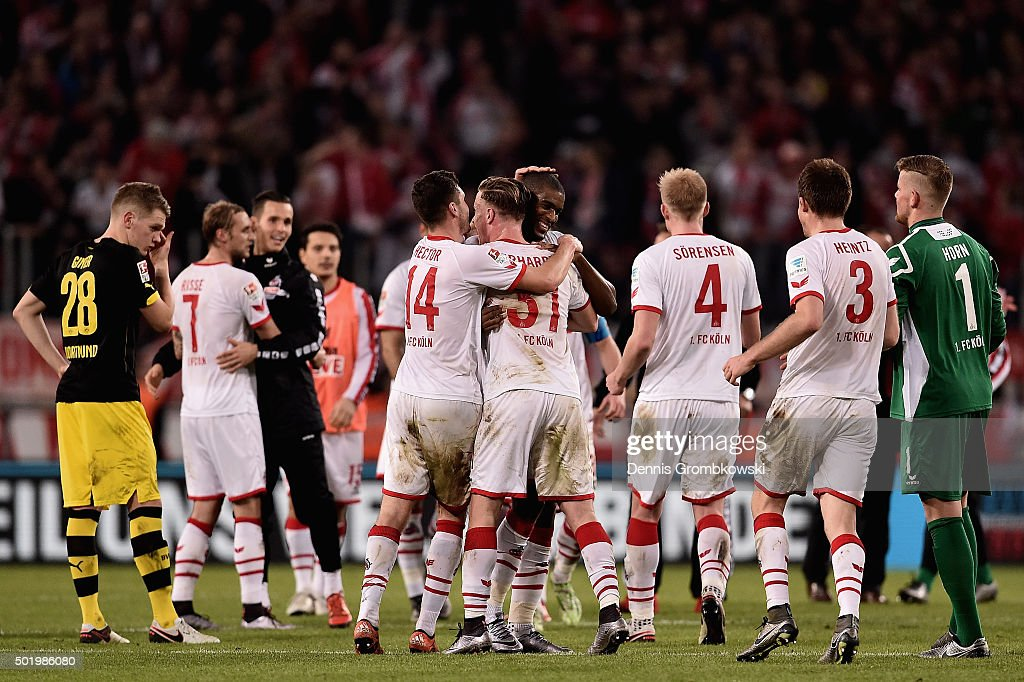 Koeln players celebrate with Anthony Modeste after the Bundesliga match between 1. FC Koeln and Borussia Dortmund at RheinEnergieStadion on December 19, 2015 in Cologne, Germany.