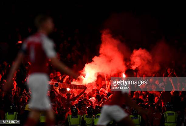 Koeln supporters light flares during the UEFA Europa League group H match between Arsenal FC and 1 FC Koeln at Emirates Stadium on September 14 2017...