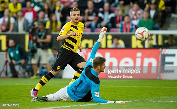 Koeln's goal keeper Timo Horn is without a chance against Borussia Dortmund's Ciro Immobile while he scores the goal to make it 11 during the...