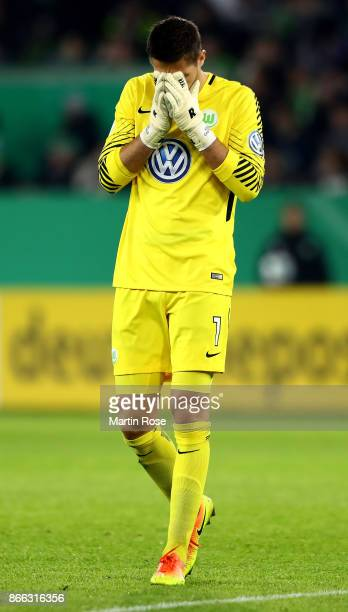 Koen Casteels goalkeeper of Wolfsburg reacts during the DFB Cup match between VfL Wolfsburg and Hannover 96 at Volkswagen Arena on October 25 2017 in...
