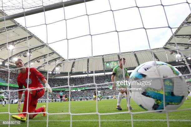 Koen Casteels of VfL Wolfsburg can't save Dortmund's third goal during the Bundesliga match between VfL Wolfsburg and Borussia Dortmund at Volkswagen...