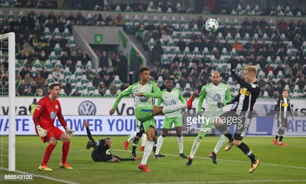 Koen Casteels of Wolfsburg and Raffael of Borussia Moenchengladbach and Ohis Felix Uduokhai of Wolfsburg and Josuha Guilavogui of Wolfsburg and John...
