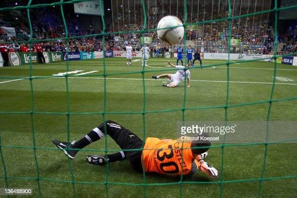 Koen Castels of Hoffenheim saves the penalty of Christopher Lamprecht of Offenbach during the penalty shootout of the Licher Hesse Cup 2012 semifinal...