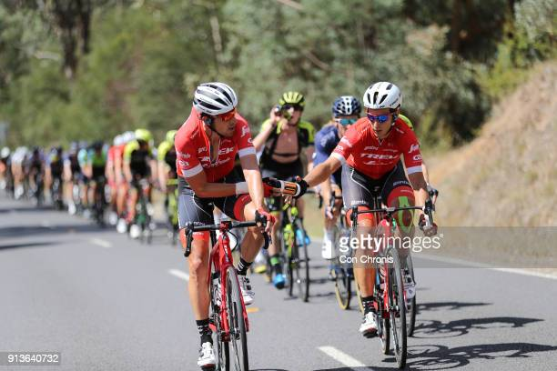 Koen De Kort of Netherlands and the TrekSegafredo Team passes teamate /Alex Frame of New Zealand and the TrekSegafredo Team a water bottle during the...