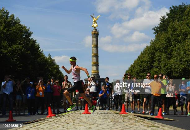 Koen Naert of Belgium leads as he races past the Berlin Victory Column in the Men's Marathon final during day six of the 24th European Athletics...