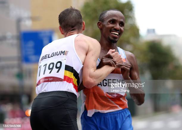Koen Naert of Team Belgium and silver medalist Abdi Nageeye of Team Netherlands react after competing in the Men's Marathon Final on day sixteen of...