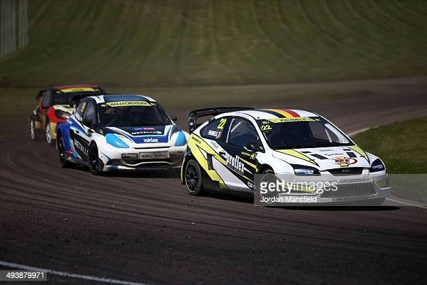Koen Pauwels of Belgium leads Tord Linnerud of Noway and Alexander Hvaal of Noway into a corner of a corner drives during the FIA World Rallycross...