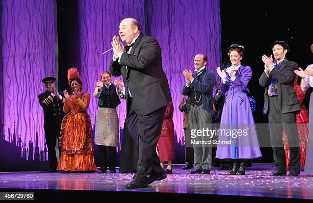 Koen Schoots and some members of the cast pose on stage during the Mary Poppins musical premiere at Ronacher Theater on October 1 2014 in Vienna...