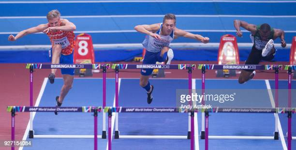 Koen Smet of the Netherlands David King of Great Britain and Ahmad KhA AlMolad of Saudi Arabia during the Semi Final of the Men's 60m Hurdles on Day...