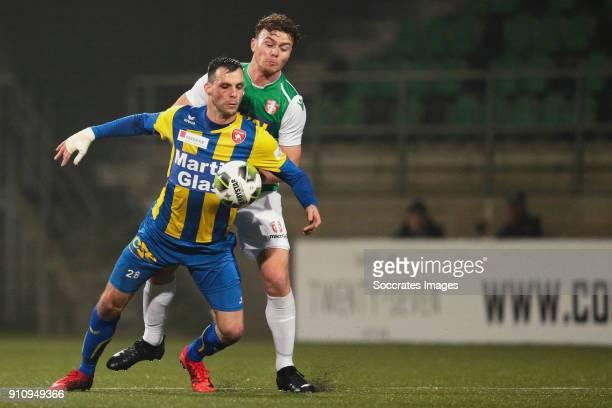 Koen van der Biezen of FC Oss Julius Bliek of FC Dordrecht during the Dutch Jupiler League match between FC Dordrecht v FC Oss at the Riwal...
