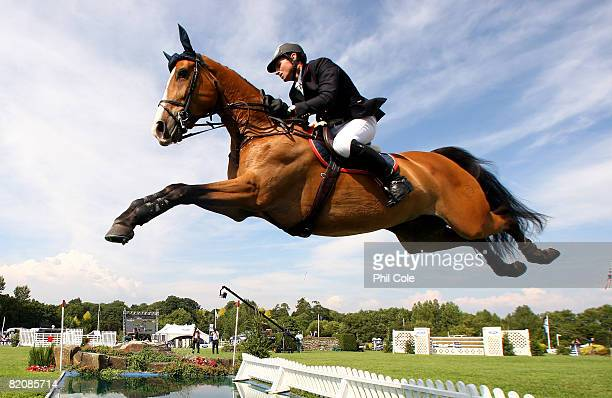 Koen Vereecke of Belgium riding Utopia VD Donkhoeve during the Longines King George V Gold Cup on July 27 in Hickstead England