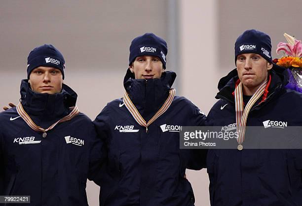 Koen Verweij Jan Blokhuijsen and Berden de Vries of the Netherlands pose on the podium with their medals after the Men's 3000 meters during the ISU...