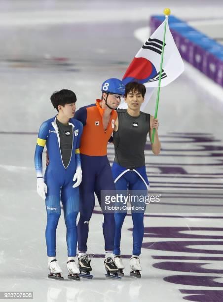 Koen Verweij of the Netherlands congratulates SeungHoon Lee of Korea winning gold in the Men's Speed Skating Mass Start Final on day 15 of the...